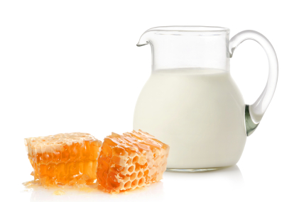 Glass jug with milk and honey